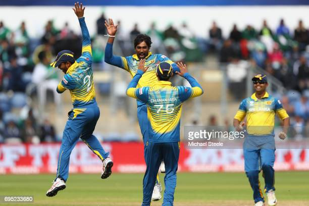 Nuwan Pradeep of Sri Lanka celebrates with Kusal Mendis after capturing the wicket of Imad Wasim of Pakistan during the ICC Champions Trophy match...