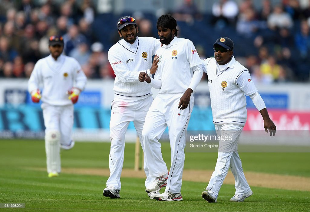 Nuwan Pradeep of Sri Lanka celebrates with teammates after dismissing Joe Root of England during day one of the 2nd Investec Test match between England and Sri Lanka at Emirates Durham ICG on May 27, 2016 in Chester-le-Street, United Kingdom.