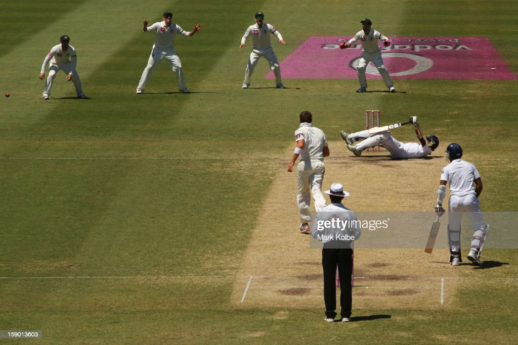 Nuwan Pradeep of Sri Lanka falls to the ground after facing a short ball during day four of the Third Test match between Australia and Sri Lanka at Sydney Cricket Ground on January 6, 2013 in Sydney, Australia.