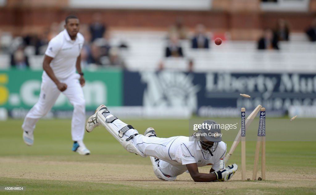 Nuwan Pradeep of Sri Lanka hits his wicket avoiding a short ball from <a gi-track='captionPersonalityLinkClicked' href=/galleries/search?phrase=Chris+Jordan+-+Cricket+Player&family=editorial&specificpeople=12855183 ng-click='$event.stopPropagation()'>Chris Jordan</a> of England during day four of 1st Investec Test match between England and Sri Lanka at Lord's Cricket Ground on June 15, 2014 in London, England.