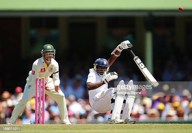 Nuwan Pradeep of Sri Lanka is hit by a bouncer during day four of the Third Test match between Australia and Sri Lanka at the Sydney Cricket Ground...
