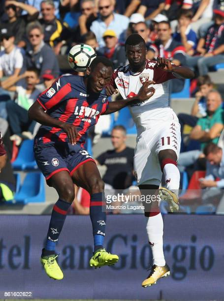 Nwankwo Simy of Crotone competes for the ball in air with M'Baye Niang of Torino during the Serie A match between FC Crotone and Torino FC at Stadio...