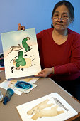 ULUKHAKTOK NWTSusie Malgokak draws on memories of a childhood stolen when she was forced to leave her family for a residential school to make stencil...