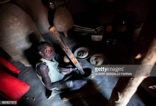 Nyadet Was prepares a meal inside a shelter in Ngop in South Sudan's Unity State on March 10 2017 The Norwegian Refugee Council distributed food for...