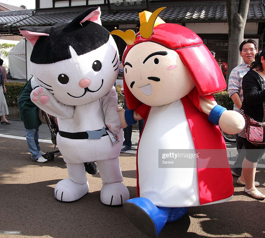 Nyajiro (L), the mascot of Akita Prefecture and Magorin, the mascot to promote Saikashu, famous army people in Wakayama prefecture in 15th century, are seen during the 'Yuru Chara Festival in Hikone' at Yumekyobashi Castle Road on October 23, 2010 in Hikone, Shiga, Japan. Yuru Chara, abbreviation of 'Yurui (unserious or relaxing)' and 'Character', are mascots of local governments, companies etc. The festival attracts 35,000 Yuru Chara fans.