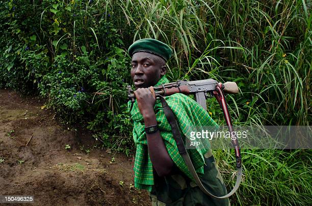 nyatura-militia-soldier-walks-up-a-hill-in-ngululu-80-km-north-west-picture-id150496325?s=612x612
