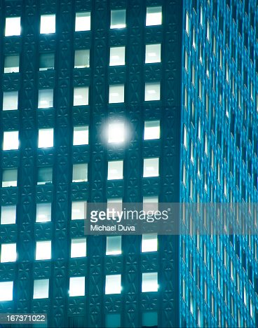 nyc office building at night w window glowing : Stock Photo