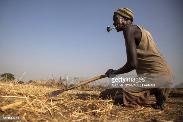 Nyebol Joul Nhial prepares the land for maize cultivation in Ngop in South Sudan's Unity State on March 10 2017 The Norwegian Refugee Council...