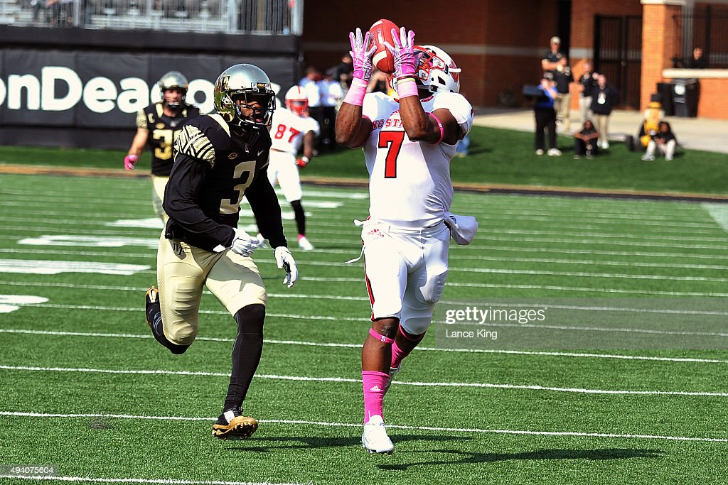 Nyheim Hines of the North Carolina State Wolfpack catches a 58yard pass for a touchdown against Devin Gaulden of the Wake Forest Demon Deacons at BBT...