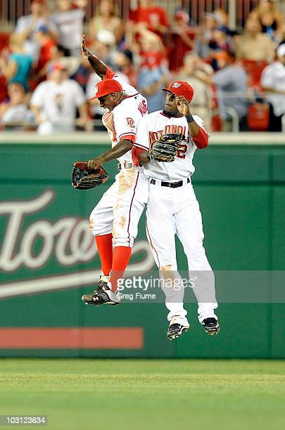 Nyjer Morgan and Roger Bernadina of the Washington Nationals celebrate after a 30 victory against the Atlanta Braves at Nationals Park on July 27...