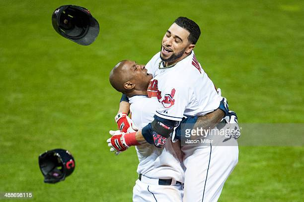 Nyjer Morgan celebrates with Mike Aviles of the Cleveland Indians after Aviles hit a walkoff single to center to defeat the Minnesota Twins at...