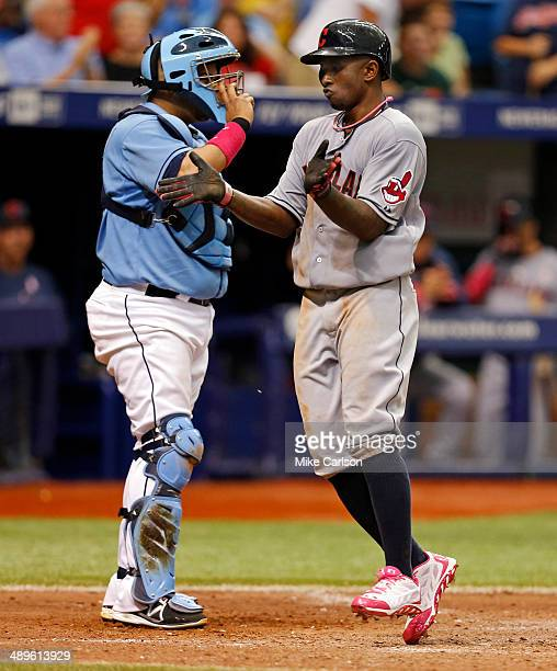 Nyjer Morgan of the Cleveland Indians celebrates his home run in front of catcher Jose Molina of the Tampa Bay Rays during the eighth inning of a...