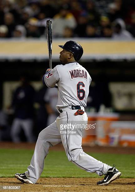 Nyjer Morgan of the Cleveland Indians hits a sacrifice fly that scored Asdrubal Cabrera in the eighth inning of their game against the Oakland...
