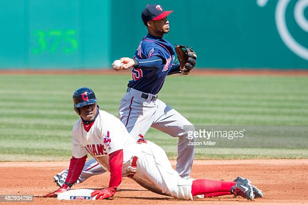 Nyjer Morgan of the Cleveland Indians is out at second as shortstop Pedro Florimon of the Minnesota Twins throws t first off a grind ball hit by Nick...