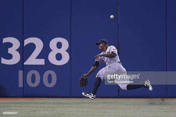 Nyjer Morgan of the Cleveland Indians misplays a double in the fifth inning during MLB game action by Adam Lind of the Toronto Blue Jays on May 14...