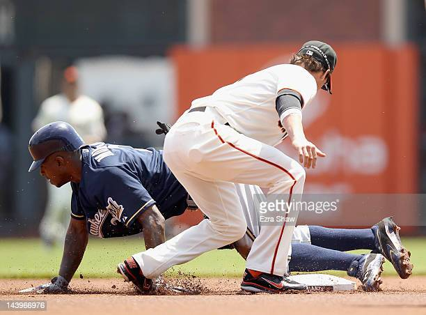 Nyjer Morgan of the Milwaukee Brewers beats the tag of Ryan Theriot of the San Francisco Giants to steal second base in the first inning at ATT Park...