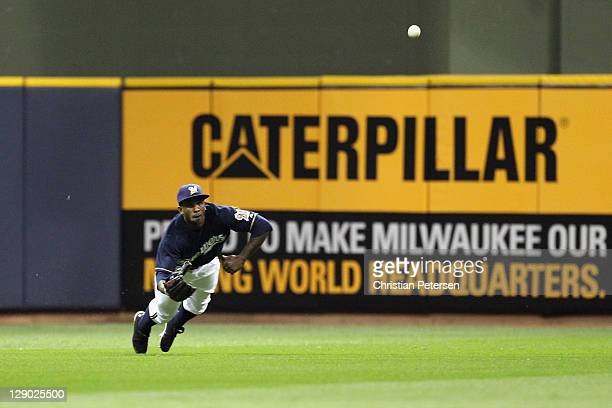 Nyjer Morgan of the Milwaukee Brewers can't make a play on a single hit by Edwin Jackson of the St Louis Cardinals in the top of the third inning...