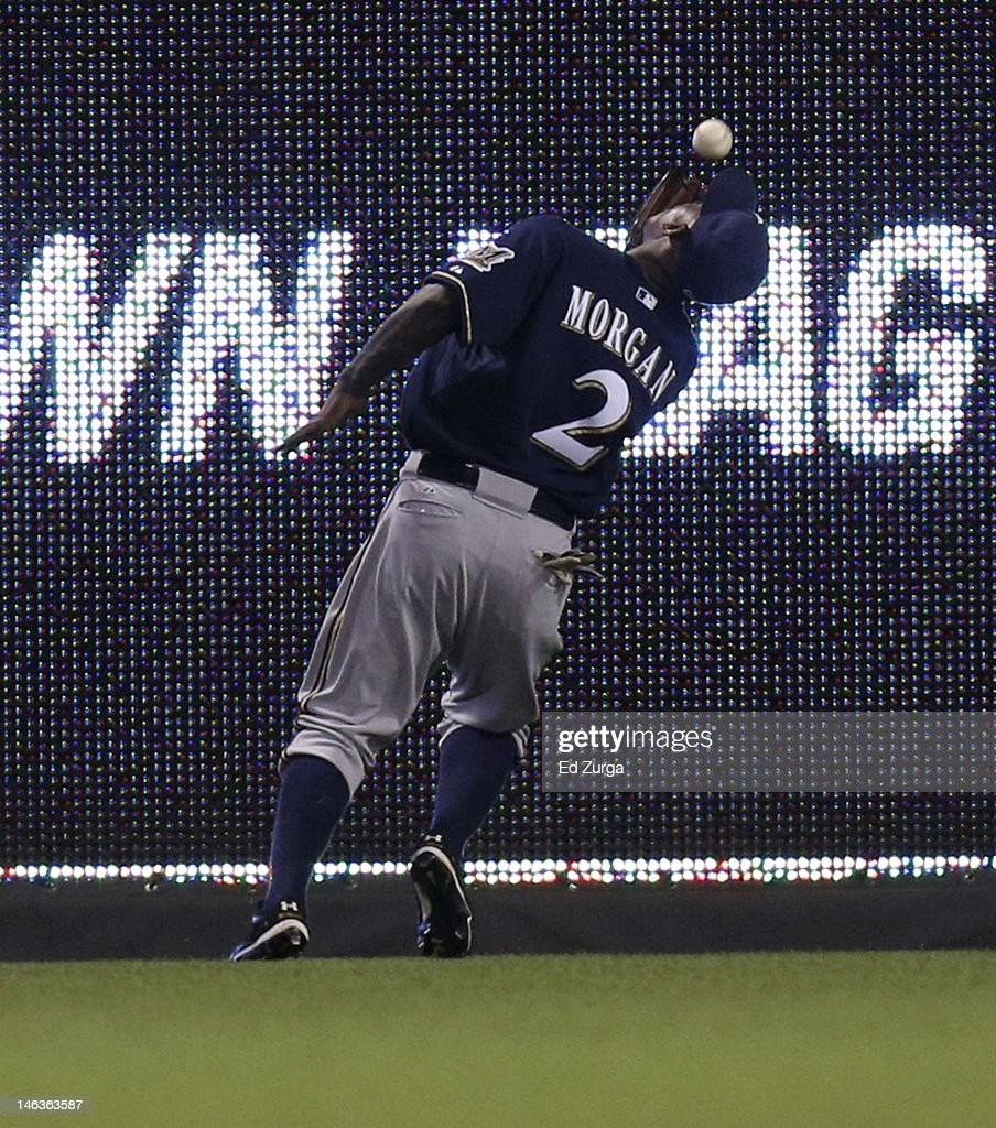 <a gi-track='captionPersonalityLinkClicked' href=/galleries/search?phrase=Nyjer+Morgan&family=editorial&specificpeople=4175372 ng-click='$event.stopPropagation()'>Nyjer Morgan</a> #2 of the Milwaukee Brewers catches a ball hit by Humberto Quintero of the Kansas City Royals during an interleague game in the seventh inning at Kauffman Stadium on June 14, 2012 in Kansas City, Missouri.