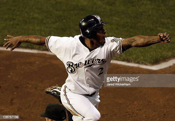 Nyjer Morgan of the Milwaukee Brewers celebrates after scoring the tying run on a sacrifice fly in the fourth inning against the Arizona Diamondbacks...