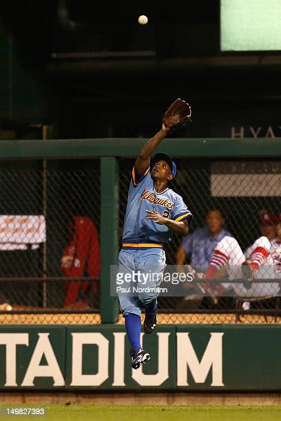 Nyjer Morgan of the Milwaukee Brewers leaps for a fly ball against the St Louis Cardinals at Busch Stadium on August 4 2012 in St Louis Missouri