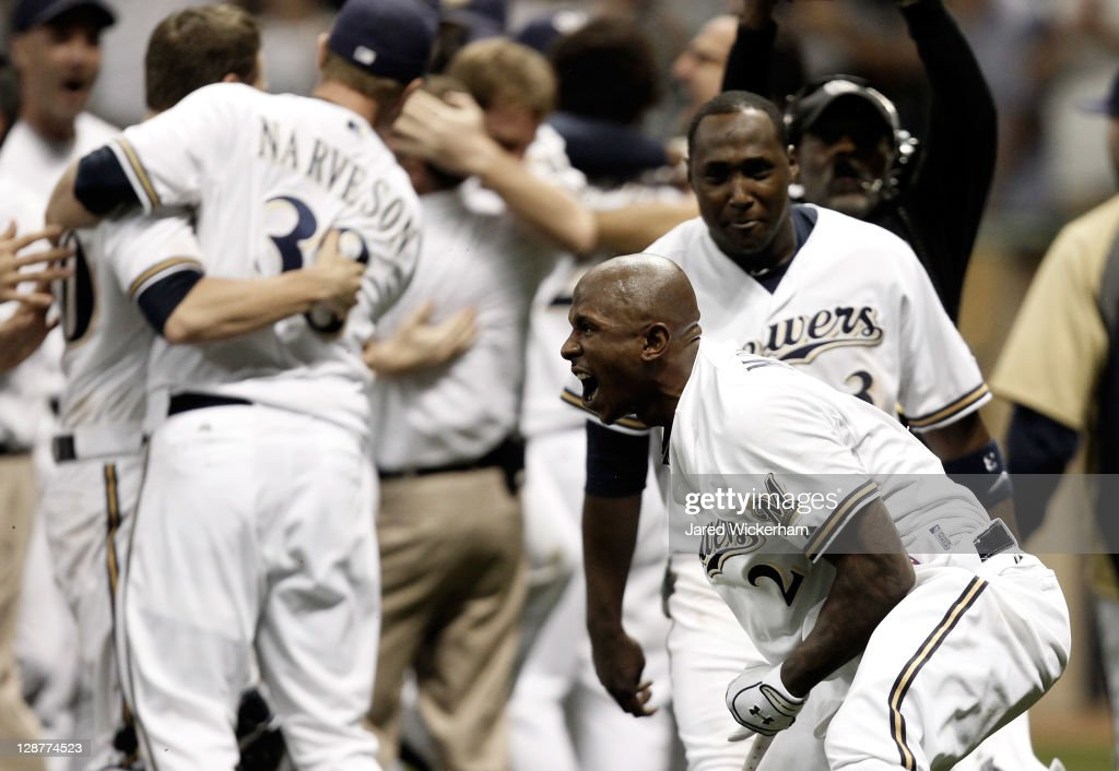 Nyjer Morgan #2 of the Milwaukee Brewers reacts with teammates after getting the game-winning RBI scoring teammate Carlos Gomez #27 to defeat the Arizona Diamondbacks 3-2 in 10 innings in Game Five of the National League Division Series at Miller Park on October 7, 2011 in Milwaukee, Wisconsin.