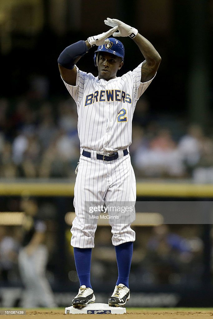 <a gi-track='captionPersonalityLinkClicked' href=/galleries/search?phrase=Nyjer+Morgan&family=editorial&specificpeople=4175372 ng-click='$event.stopPropagation()'>Nyjer Morgan</a> #2 of the Milwaukee Brewers signals for time out after hitting a double against the Pittsburgh Pirates in the bottom of the first inning at Miller Park on August 31, 2012 in Milwaukee, Wisconsin.