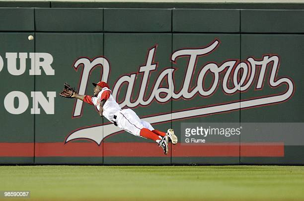Nyjer Morgan of the Washington Nationals dives for a fly ball during the game against the Colorado Rockies April 20 2010 at Nationals Park in...