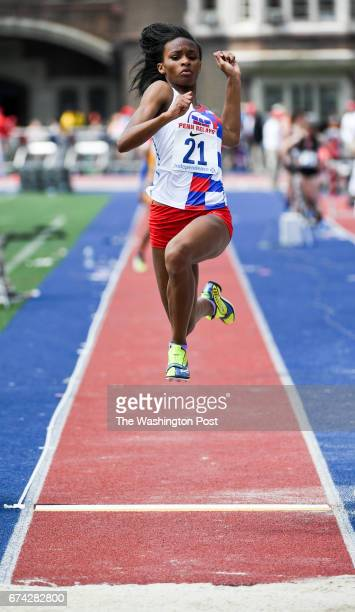 Nyla Ward of TC Williams High launches herself during the long jump competition during the 123rd running of the Penn Relays in Philadelphia PA on...