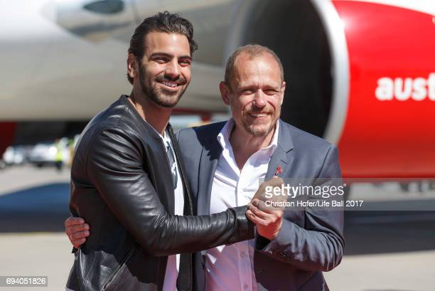 Nyle DiMarco and Life Ball organizer Gery Keszler arrive on the Life Ball plane on June 9 2017 in Vienna Austria The Life Ball an annual charity ball...