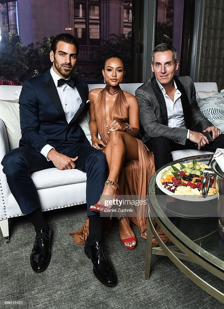 Nyle DiMarco Karrueche Tran and the CEO of Wilhelmina Models Bill Wackermann prepare for the 7th Annual amfAR Inspiration Gala at the offices of...