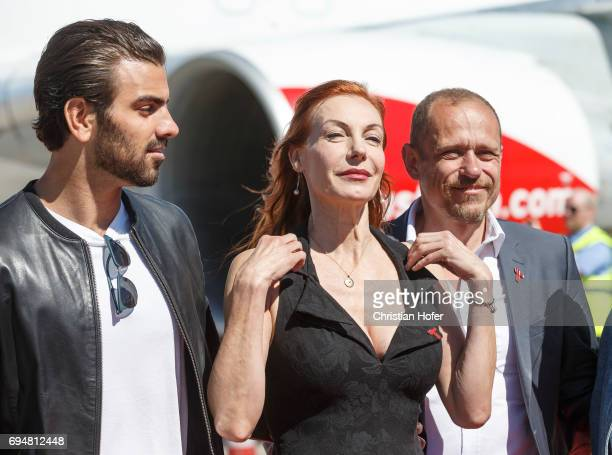Nyle DiMarco Ute Lemper and Life Ball organizer Gery Keszler arrive on the Life Ball plane on June 9 2017 in Vienna Austria The Life Ball an annual...
