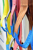 Multicolored nylon soft lifting slings. Warehouse of finished products for industrial enterprises