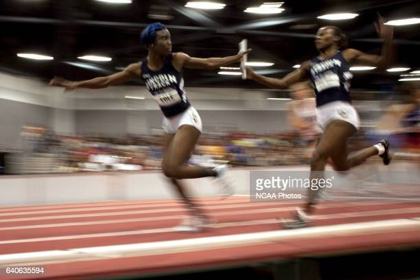 Nyoka Cole of Lincoln Mo takes the baton from Michelle Cumberbatch in the women's 4X400 meter race during the Division II Men's and Women's Indoor...