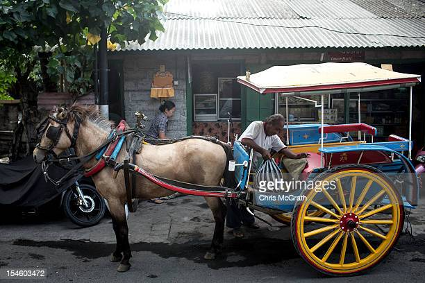 Nyoman Mantra Manik does deliveries in his Dokar on October 14 2012 in Denpasar Bali Indonesia The Dokar is traditional local transport used in...