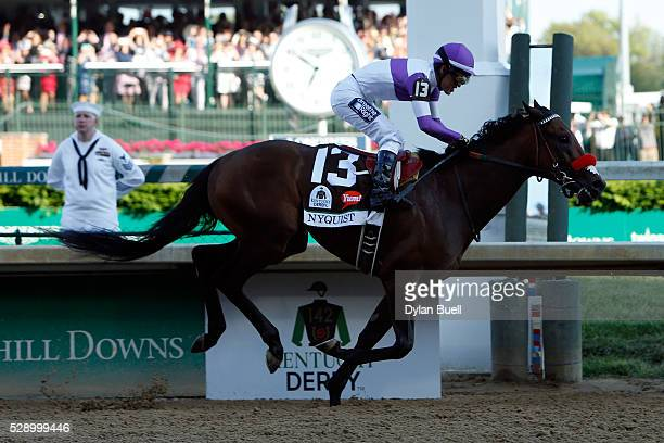 Nyquist ridden by Mario Gutierrez crosses the finish line to win the 142nd running of the Kentucky Derby at Churchill Downs on May 07 2016 in...