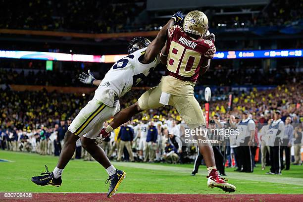 Nyqwan Murray of the Florida State Seminoles scores a touchdown in the fourth quarter against the Michigan Wolverines during the Capitol One Orange...