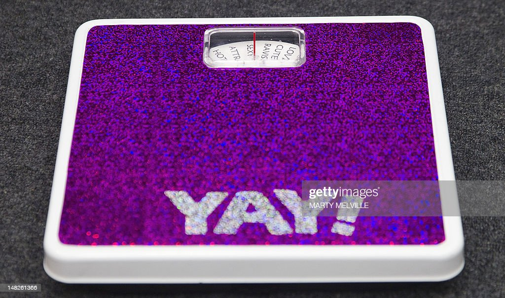 NZealand-health-obesity-lifestyle, FOCUS by Neil Sands In a picture taken on July 12, 2012, a scale belonging to conference organiser Cat Pause is seen during New Zealand's first fat conference at Massey University in Wellington. Cat Pause proudly describes herself as 'fat', can live with euphemisms like 'curvy', 'chunky' or 'chubby', but baulks at what she believes are value-laden labels such as 'overweight' or 'obese'.