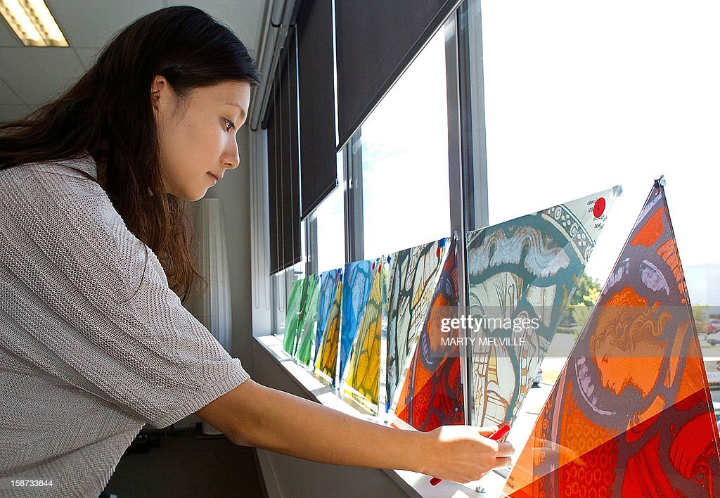 NZealand-Japan-quake-architecture-Ban,FEATURE by Neil Sands This photo taken on December 5, 2012 shows architect Shigeru Ban's associate architect, Yoshie Narimatsu, looking at samples of stain glass windows for the new cardboard Christchurch Cathedral. When Japanese architect Shigeru Ban designed a new cathedral in earthquake-devastated Christchurch, he chose the most unlikely of materials -- cardboard -- for the landmark project. The New Zealand city's magnificent Gothic revival cathedral hewn from local basalt was irreparably damaged in the 6.3-magnitude earthquake that claimed 185 lives on February 22, 2011.