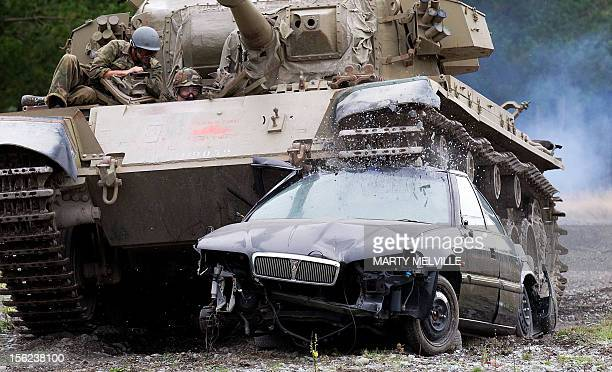 NZealandtourismtanksMotoringoffbeat by Neil Sands This photo taken on Feburary 24 2012 shows Michael Noal from Vancouver crushing a car with a...