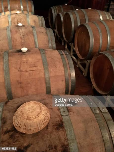 Oak barrels stored in a climate controlled area during the fermentation process