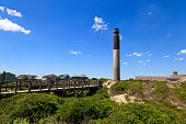 Located in Caswell Beach, North Carolina, built in 1958, 148 foot tall beacon