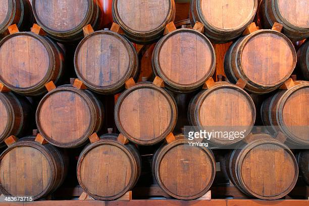 Oak Wine Barrels Stacked in Winery Cellar, Napa Valley, California
