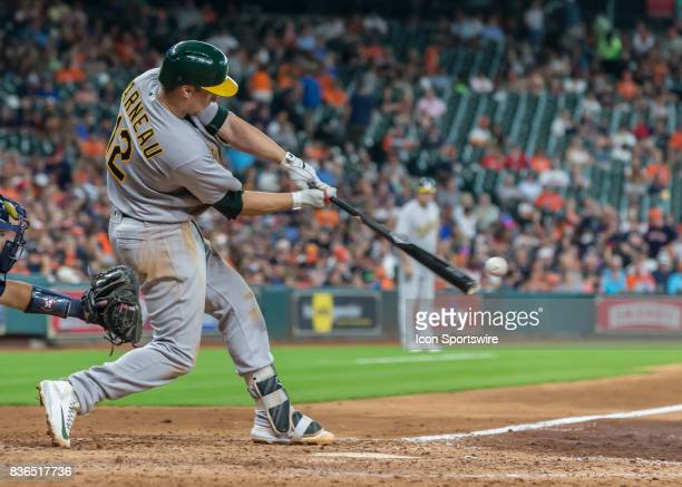 Oakland Athletics catcher Dustin Garneau hits a foul ball in the fifth inning of the MLB game between the Oakland Athletics and Houston Astros on...