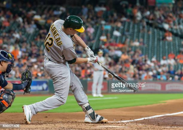 Oakland Athletics catcher Dustin Garneau hits several foul balls before earning a walk in the fifth inning of the MLB game between the Oakland...