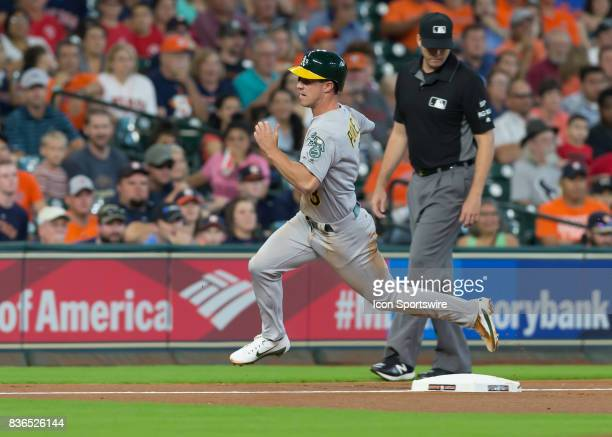 Oakland Athletics center fielder Boog Powell rounds third base and heads to home plate to score a run in the first inning of the MLB game between the...
