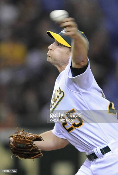 Oakland Athletics closer Lenny DiNardo pitches the ball in the last inning against Japan's Hanshin Tigers in an exhibition game in Tokyo Dome on...