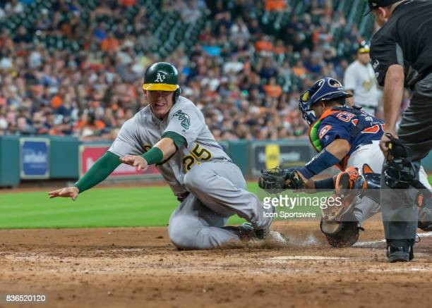 Oakland Athletics designated hitter Ryon Healy gets tagged out at home plate by Houston Astros catcher Juan Centeno in the sixth inning of the MLB...