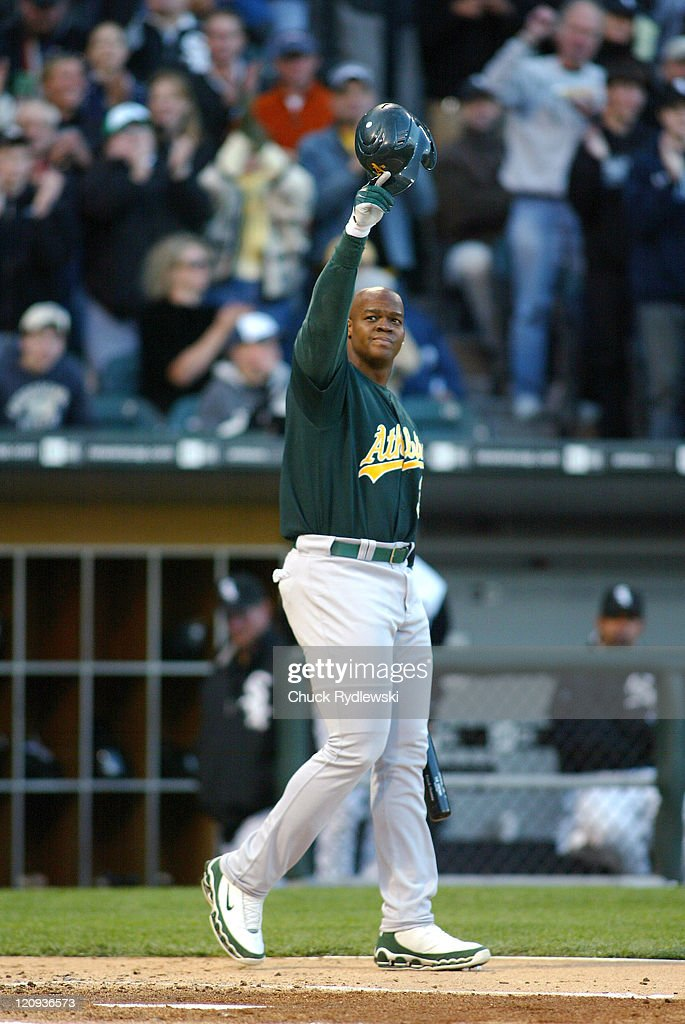 Oakland Athletics' DH and exWhite Sox Frank Thomas acknowledges the fans standing ovation prior to his first at bat during their game against the...