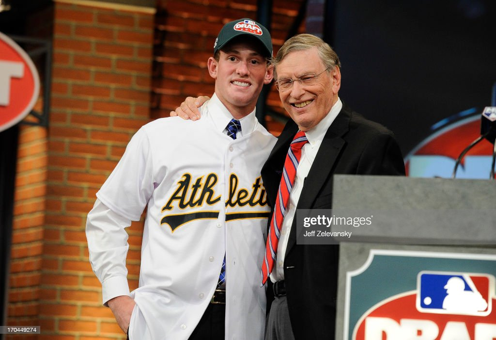 Oakland Athletics draftee Billy McKinney (L) poses for a photograph with Major League Baseball Commissioner <a gi-track='captionPersonalityLinkClicked' href=/galleries/search?phrase=Bud+Selig&family=editorial&specificpeople=211472 ng-click='$event.stopPropagation()'>Bud Selig</a> at the 2013 MLB First-Year Player Draft at the MLB Network on June 6, 2013 in Secaucus, New Jersey.