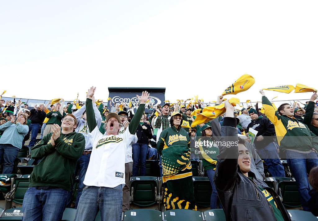 Oakland Athletics fans cheer for their team during a pregame ceremony before their game against the Seattle Mariners on Opening Day at O.co Coliseum on April 1, 2013 in Oakland, California.